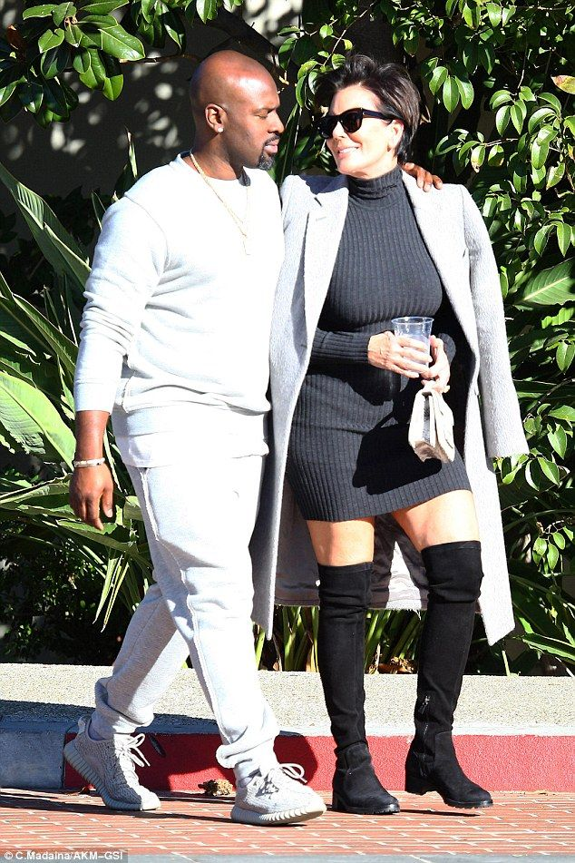 So in love: Corey Gamble put a protective arm round Kris Jenner as she gazed into his eyes during a romantic stroll in Westlake Village on Wednesday
