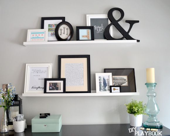 Master Bedroom Picture Wall - use ledges to create height. This also makes swapping out frames a breeze.