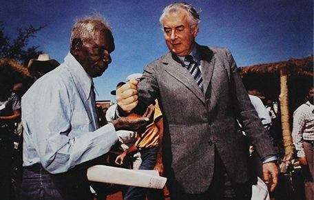 Wave Hill Walk Off by the Gurindji people lead by Vincent Lingiari.  Gough Whitlam poured the local sand into Vincent Lingiari's hands, symbolically handing the Wave Hill station back to the Gurindji people nine years later, Wattie Creek, NT / Mervyn Bishop