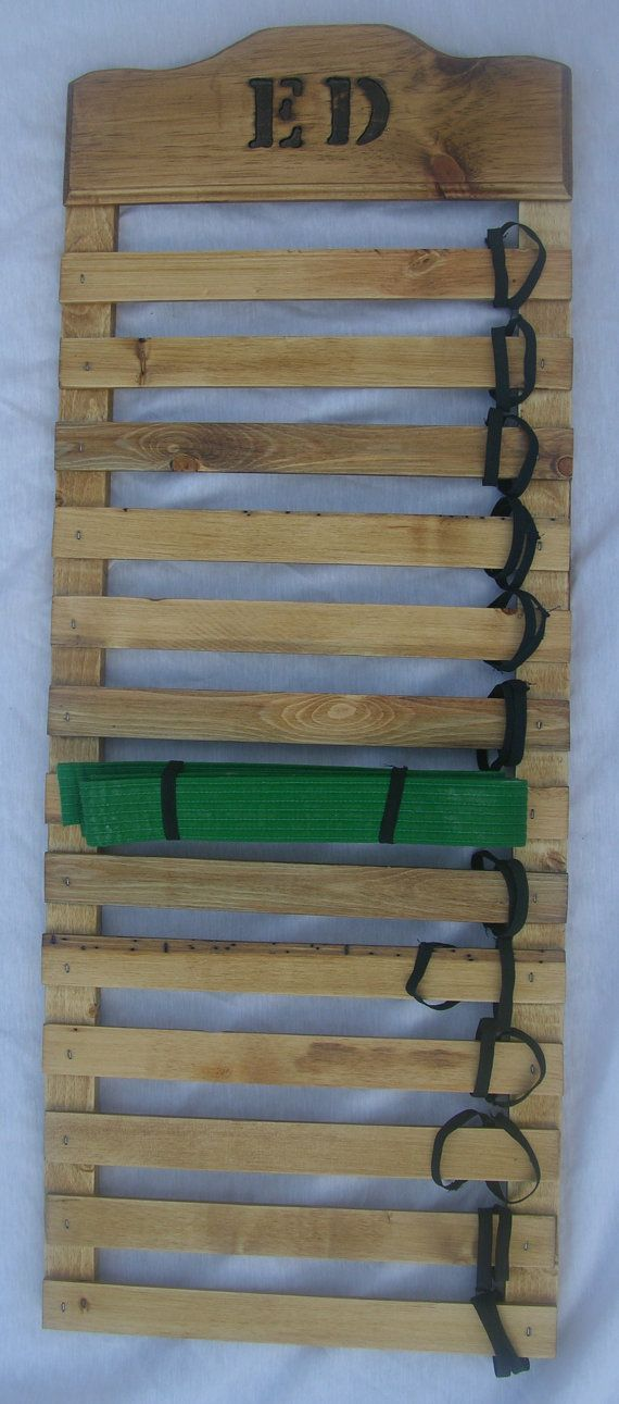 Hubby could make one like this!! Personalized??... Personalized karate belt display rack with name carved into top slates. Can be made with 5 to 13 spaces for belts. Elastic holds belts in