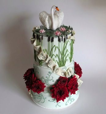 'Swan Lake' cake for Stella's 80th birthday - carrot, chocolate and cherry cakes filled and coated with ganache, all fondant iced with handmade and dusted flowers, hand painted banners, piped details and cherry cake-filled swan (see design at https://uk.pinterest.com/pin/491314640584512414/)
