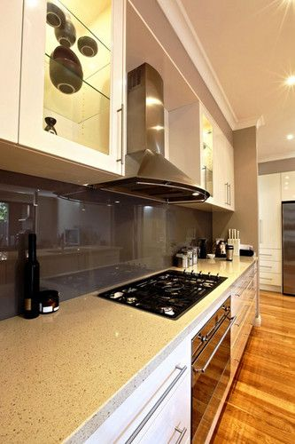 Modern white 2 pack kitchen with Caesar stone benchtop. www.buildingworksaust.com.au #sydney