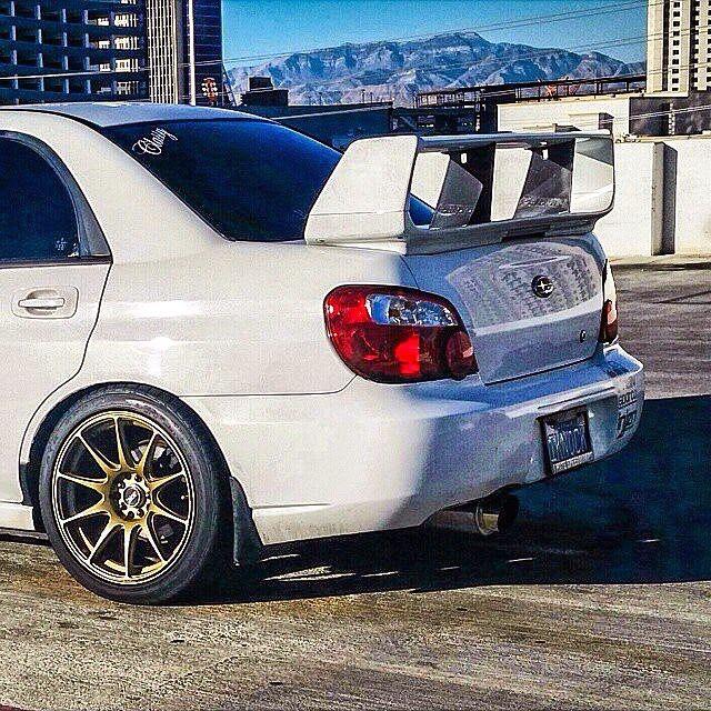 White. Subaru Impreza ...