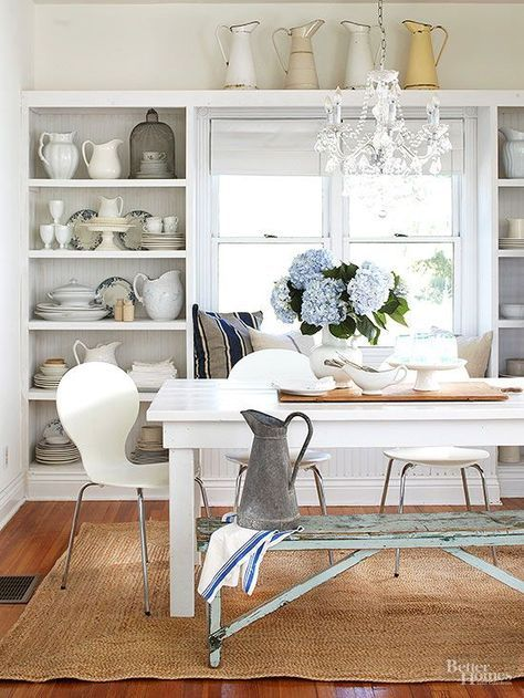 Collections with barnyard beginnings transform city, rural, and suburban spaces into country-charming quarters. In this kitchen, milk pitchers -- in galvanized steel, with chipped enamel finishes, and in assorted white porcelain shapes -- evoke images of bawling cows and farm chores.