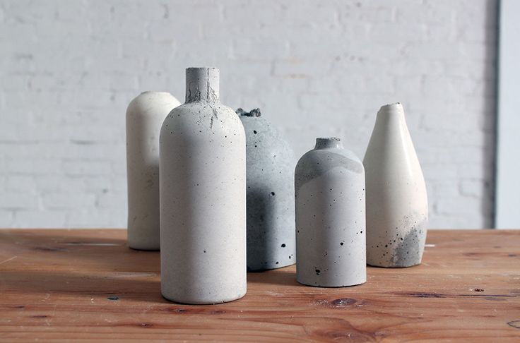 Use Old Bottles to Make Chic Concrete Vases - using plastic or glass bottles. brit.co  DIY tutorial