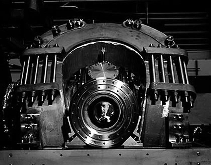 Ansel Adams took this picture of Dr Charles Damm, peering out of the central coil of the ALICE fusion installation, at Livermore Laboratories in 1966. California Museum of Photography, University of California, Riverside.