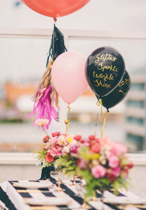Gold writing on black balloons. Perfect for a New Year's Eve party!