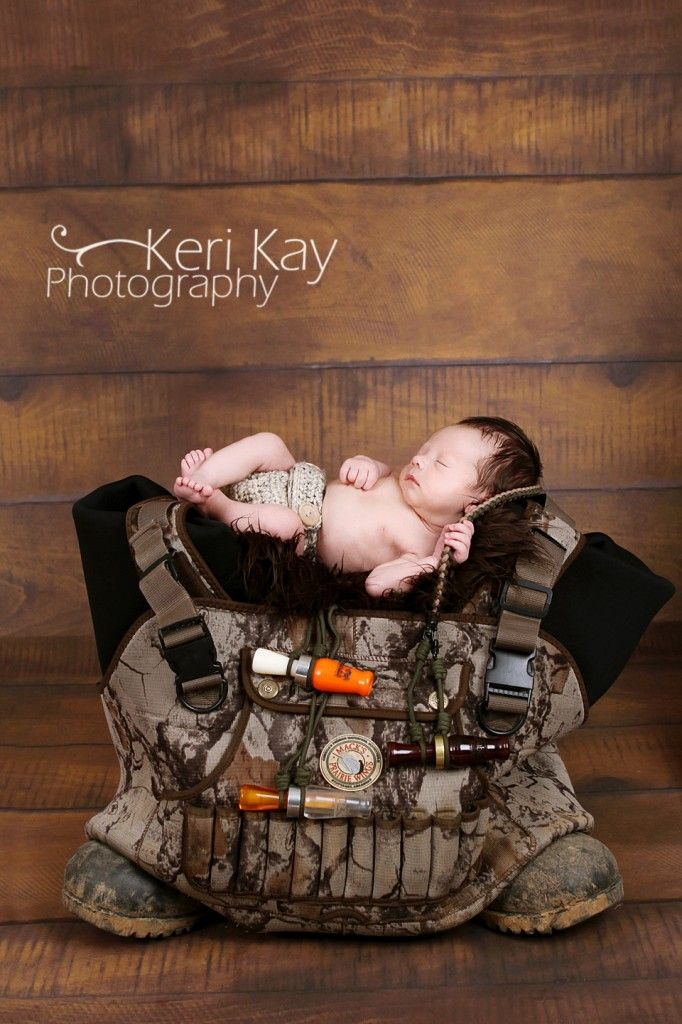 Seriously! I have the next pose for our next baby! On daddies duck gear, love it!