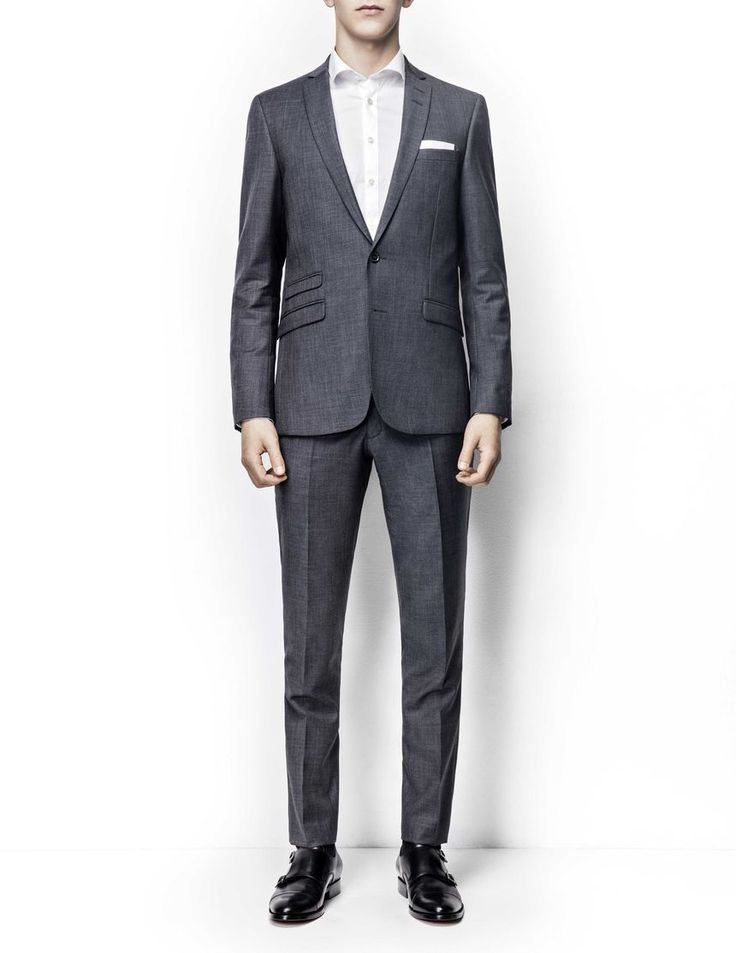 Nedvin wool suit -Men's slim fit suit in wool. High crochet, slimmed lapels and flap pockets. Two-button front closure. Comes with Herris trousers featuring low rise, narrow leg and slim fit for modern, clean profile.