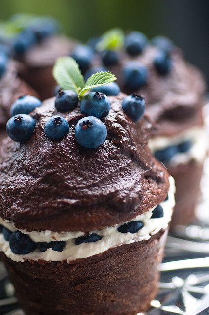 Chocolate cupcakes filled with blueberry cream and topped with dark chocolate ganache