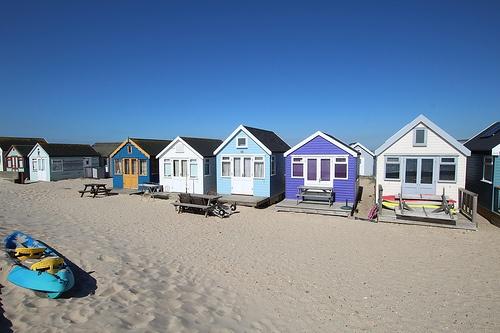 Hengistbury Head beach huts in sunny Dorset.