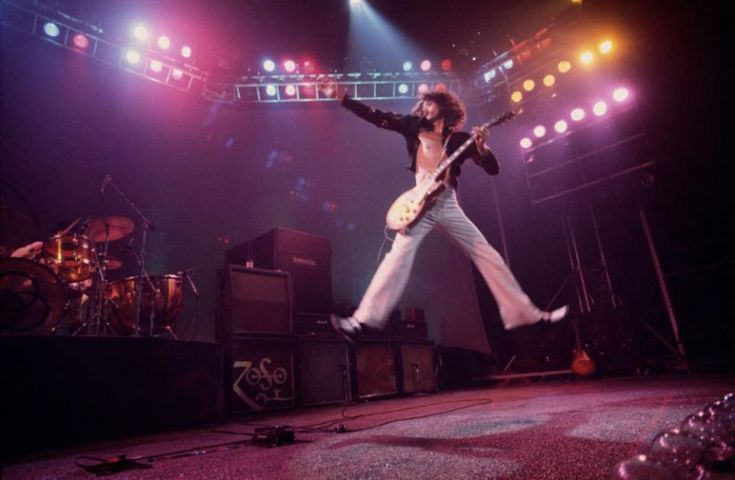 Jimmy Page jumping in mid-air in 1975!!!! He's so FRICKING cool!!!