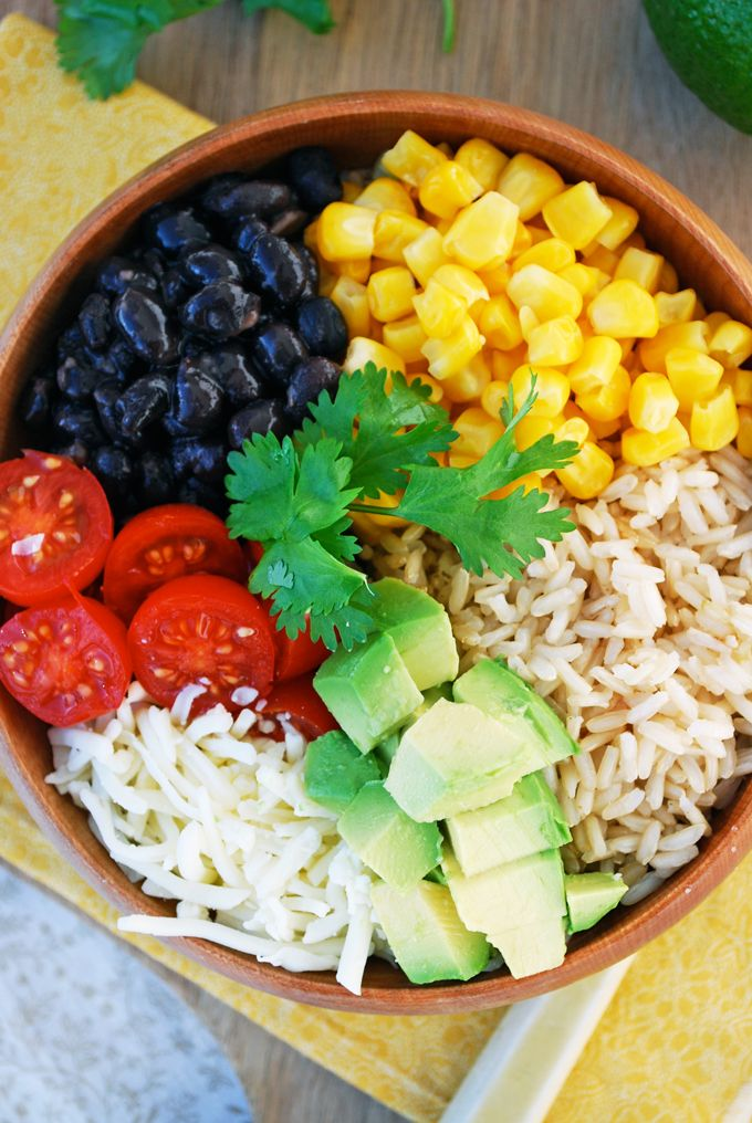 Vegetarian Burrito Bowl 1 tsp olive oil 1 clove garlic 1 can black beans Cooked Brown Rice Corn Monterey Jack Grape tomatoes, Avocado, Lime Cilantro,