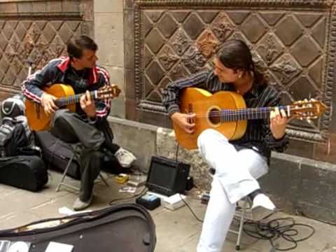 Guitar play-- Pair of flamenco guitarists outside Barcelona Cathedral in the Gothic Quarter