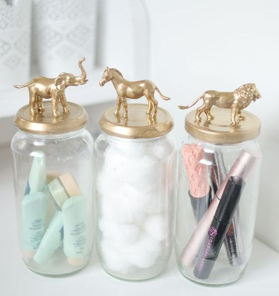 These are perfect for keeping your makeup brushes, eye pencils or cotton swabs in place with minimal effort. Just drop them in and go. You can use pretty cups, empty candle containers or customize your own Mason jar.