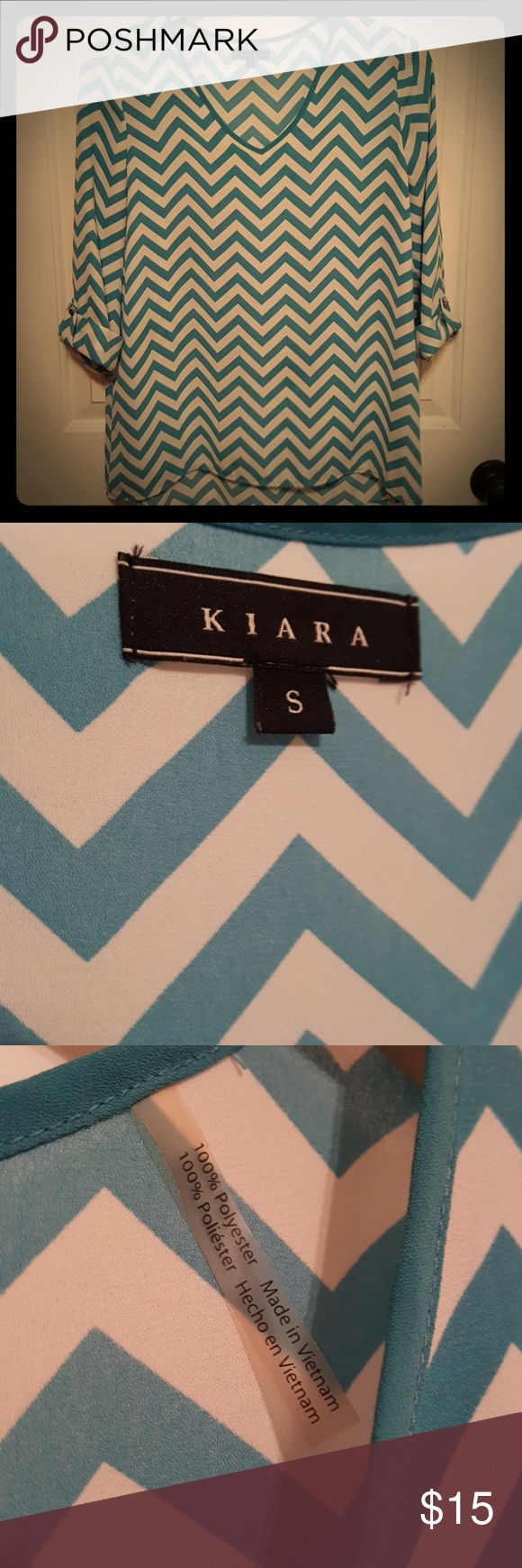 KIARA 3/4 SLEEVE CHEVRON TOP ☆Worn Once☆KIARA 3/4 SLEEVE CHEVRON TOP. Turquoise & white. Hi low style. Pullover. Buttons on sleeves for rolled look are decorative. Very cool and comfy! Feel free to SHOP my closet☆FOLLOW ME☆BUNDLE AND SAVE☆ See something you like? ☆MAKE AN OFFER!☆ LIKE IT so you can GRAB IT during a shipping DISCOUNT or price DROP! •NO TRADES• I'm always here to answer any questions you may have! KIARA Tops