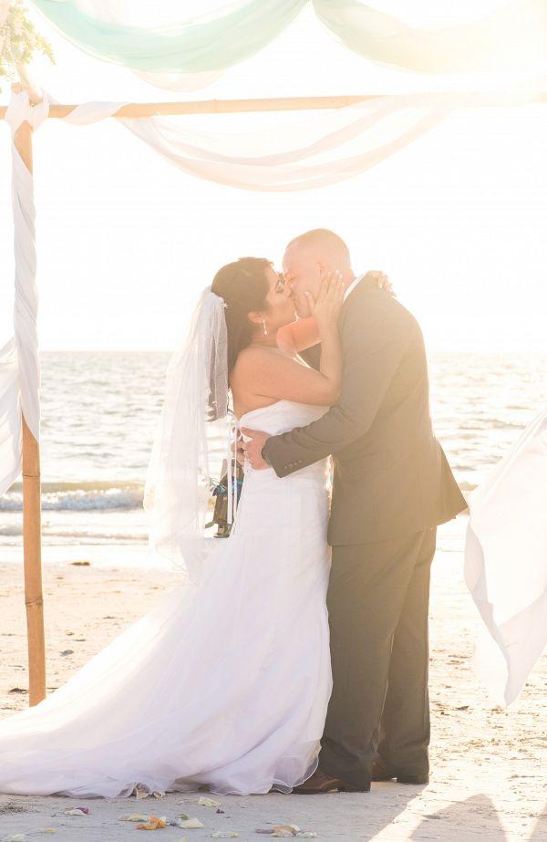 Beach ceremony on The Budget Savvy Bride    #weddings #weddingideas #aislesociety #winterwedding