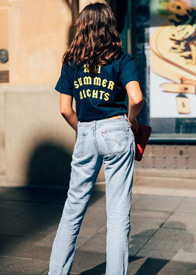 The ultimate cool girl weekend outfit: a graphic tee and boyfriend jeans