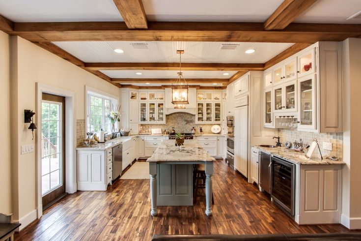 Solid wood beams, Acacia wood flooring and custom mill work set this kitchen apart. Featuring custom cabinets throughout, a wolf range, subzero fridge, ...