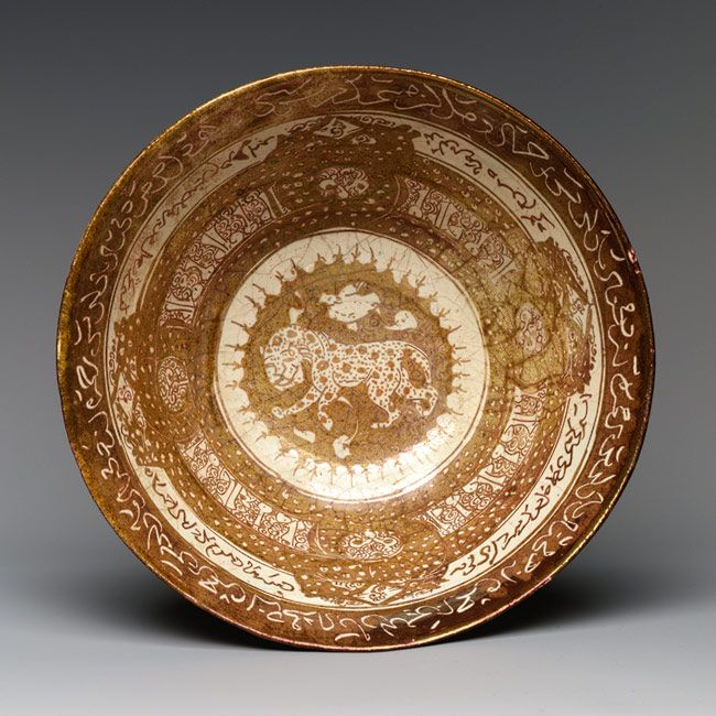 Bowl with lion, Seljuq period (1040–1196), early 13th century Attributed to Iran, Kashan Stonepaste; overglaze luster-painted on opaque white glaze