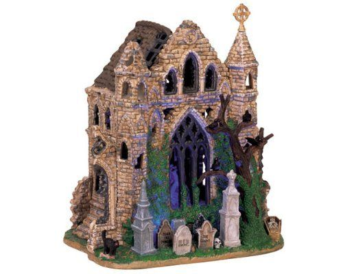 Lemax Spooky Town Village Collection Gothic Ruins Lighted Building #65342 by Lemax. I'm not embarrassed to admit that I keep this piece out year round.