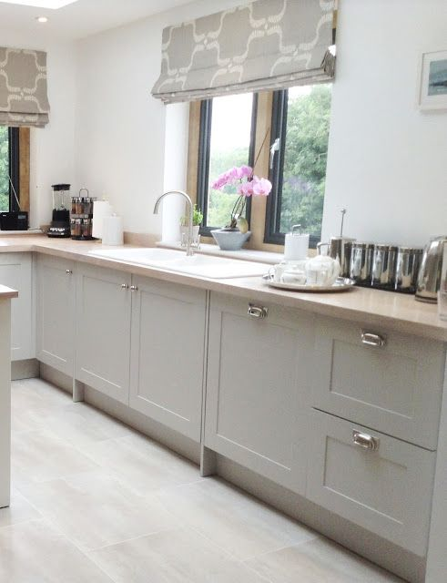 Modern country style shaker kitchen from the 'paintable' range at Just Click Kitchens. The cabinetry is supplied unfinished and ready to paint. This kitchen was hand finished in Farrow & Ball Cornforth White.