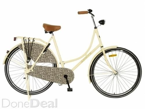 Vintage Dutch Style Bicycle  Classic, stylish bicycles for women.  Ideal for city cycling.  Available in 2 colours: Red OR Cream w/ Leopard print  Please note: Bikes are supplied unassembled in a flat pack box.  - Wheel Size: 28 Inch - Frame Height: 57cm - suitable for heights: 172-182cm (5ft6in-6ft5in) - Slot - Luxury Bell - Kickstand - Clothes Protector - Solid Steel Frame - Cloth Chain - Soft Grips - Luggage Carrier - Reflectors - Height Adjustable Seat - Height Adjustable Handlebar…