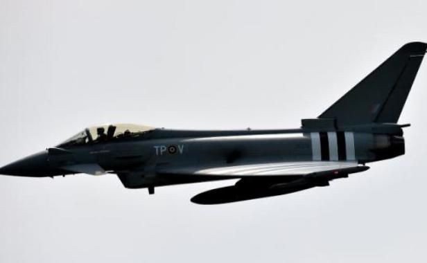 A Eurofighter Typhoon of the Royal Air Force (RAF) flight demonstration over RAF Coningsby in Lincolnshire, in central England, May 21, 2014