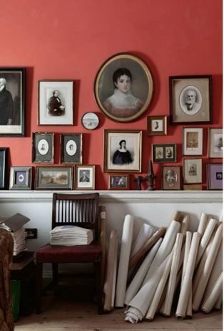 Deep coral wall filled with Antique paintings and photographs.  Mt. Rover, Ireland.