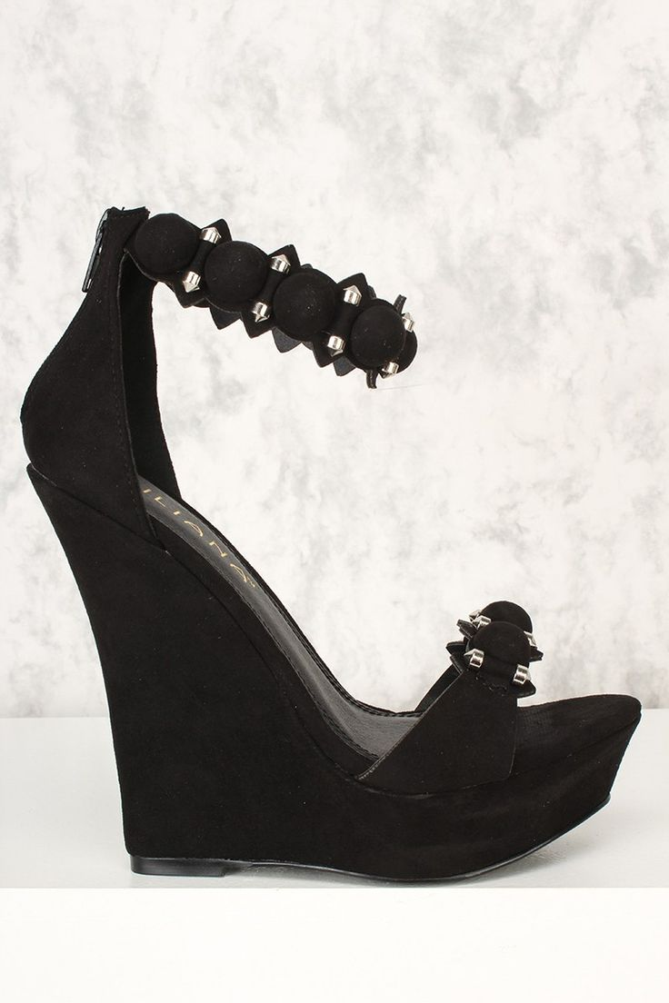 These cute wedges feature faux suede, open toe, studded detailing, platform, pointed cut out strap, back zip closure. Approximately 5 1/2 inch heel and 1 1/2 inch platform.