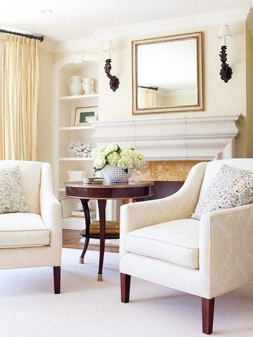 Cast stone fireplace mantle with marble surround.  |  Andrea's Innovative Interiors - Andrea's Blog - Warm up by theFire