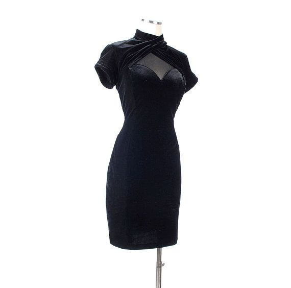 Vintage 1980s black stretch velvet party dress with see through insets over the bust and the back. Very sexy! This has a high collar with a