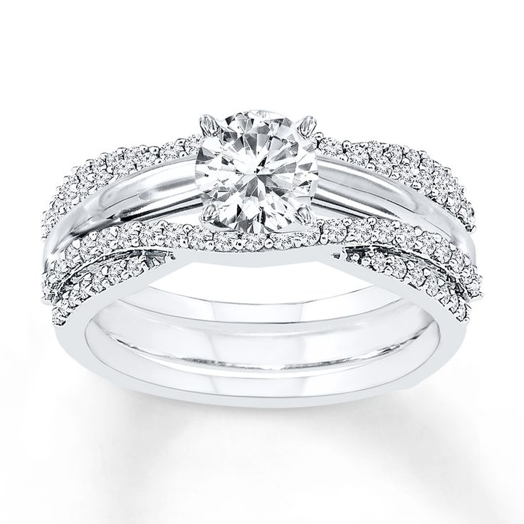 Waves of diamonds wrap her solitaire ring (sold separately) in beauty with this gorgeous enhancer band. Styled in 14K white gold, the ring has a total diamond weight of 1/2 carat. Diamond Total Carat Weight may range from .45 - .57 carats.