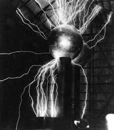 A Van de Graaff generator is an electrostatic generator which uses a moving belt to accumulate very high voltages on a hollow metal globe on the top of the stand. It was invented by American physicist Robert J. Van de Graaff in 1929. The potential difference achieved in modern Van de Graaff generators can reach 5 megavolts. The Van de Graaff generator can be thought of as a constant-current source connected in parallel with a capacitor and a very large electrical resistance.