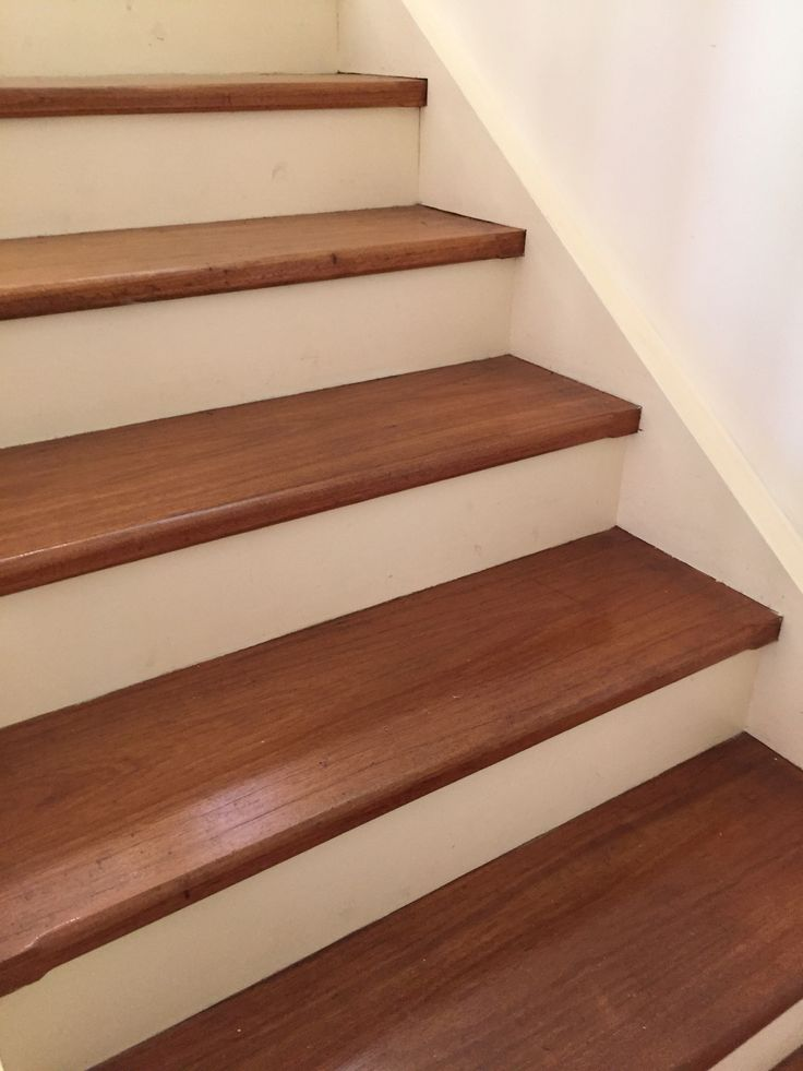 Stairs with white front wooden top with slight overhang for Hardwood skirting