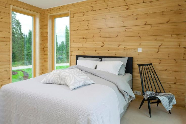 Naturally coloured pine with transparent UV  treatment by Osmo Color. Honka Log Homes.