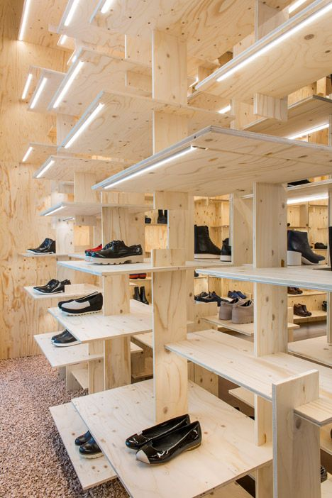 Kengo Kuma wraps the inside of Camper's Milan store in a timber grid.