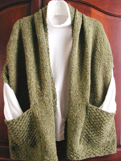 Readers Wrap Knit Pattern - It this crazy cool or what! Basically, it's a shawl with pockets.