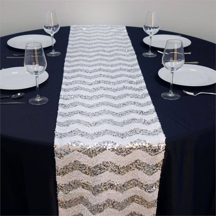 ALLURING Sequin Chevron Table Runners - Silver / White | The zig zag, wave like pattern of every one's favorite chevron design has been taken to the next level of regal attraction by adding the glitz and glam of shiny sequins, to create a masterpiece that has been fashioned with the sole purpose of exuding dazzling charisma. Two best of the best embellishing accents have been fused together to create one of a kind accessory. The upbeat chevron style has been blended with exotic sequin beads…