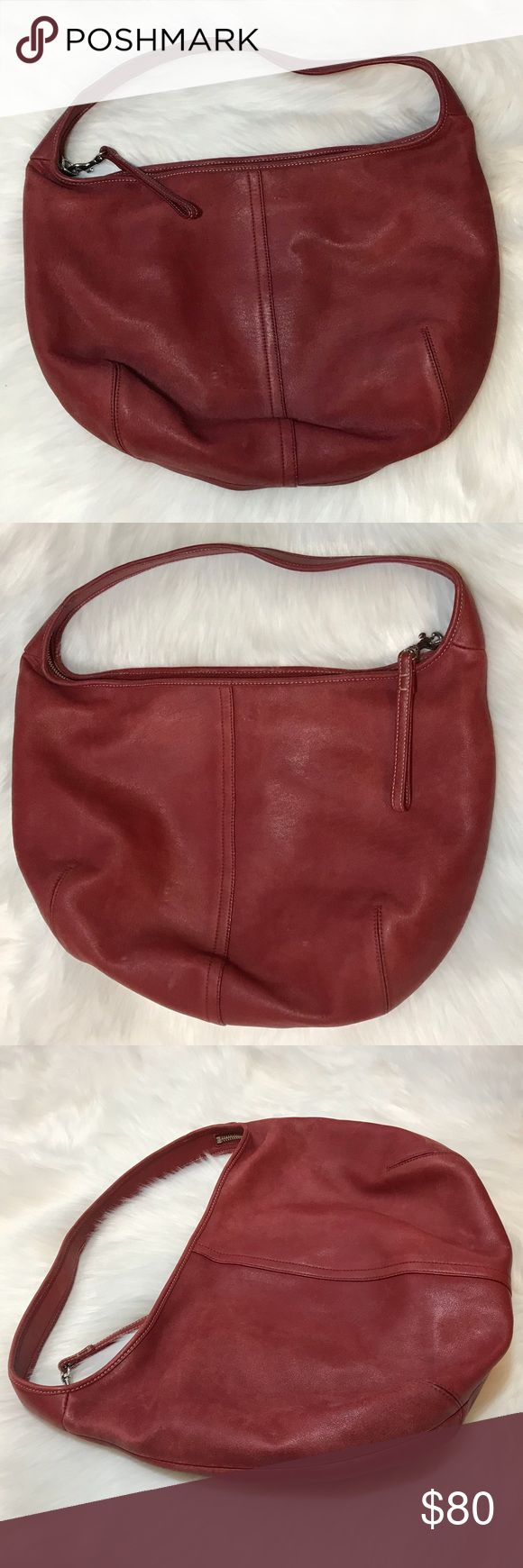 """Coach Leather Hobo Bag Deep red leather Coach hobo bag with black monogram logo lining.  Leather does have some marks, but it has aged beautifully. It is soft and plush and has no tears or abrasions. This bag is lightweight and has an easy feel to it, very boho feel. 16"""" wide and 10"""" high with a 5"""" strap drop. Practical and the quality is very nice! Coach Bags Hobos"""