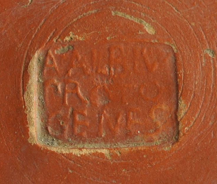 Roman stamp seal, roman potter stamp, roman inscription on terra sigillata aretina, 20-1 B.C. Roman stamp seal, roman potter stamp, roman inscription on terra sigillata aretina, central Italy, bottom of a cup with maker's name A·ALBIV / PROTO / GENES, A. Albius Protogenes, 1.2  cm long. Private collection