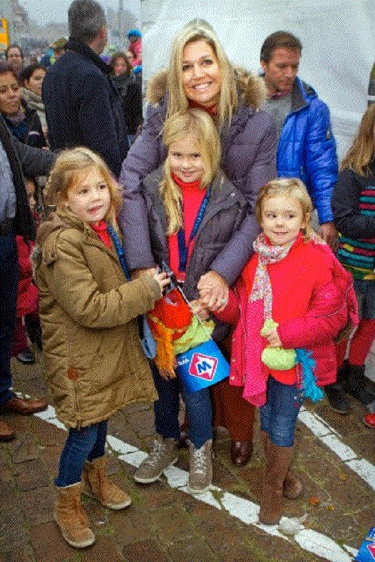 Princess Maxima with her daughters (L-R)Princess Alexia, Princess Amalia and Princess Ariane welcomes Sinterklaas and his Zwarte Pieten in the harbor of Scheveningen on 17 Nov 2012