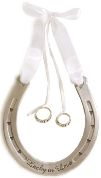 HOW CUTE! Instead of a ring bearer pillow, you have a horse shoe! oh man...