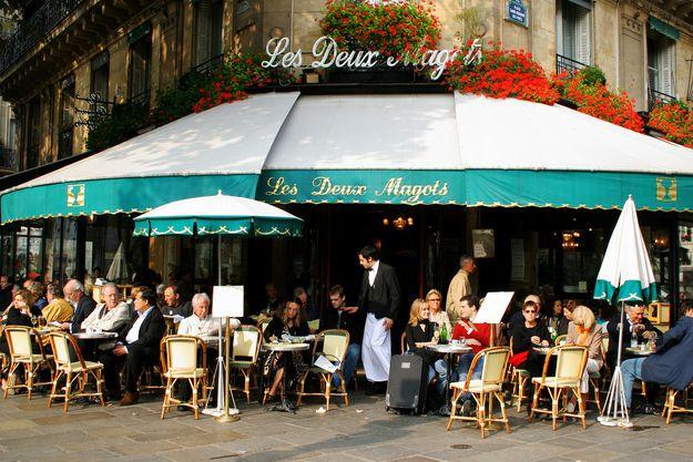 Les Deux Magots (Paris, France). Notable Patrons: Simone de Beauvoir, Jean-Paul Sartre, Albert Camus, Ernest Hemingway. Pavement cafe.