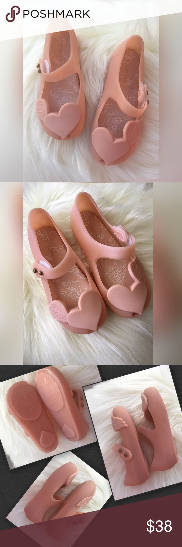 Blush Color  Heart Wing Jelly Shoe Cut out Hearts and wings graphics  on these adorable mini Melissa jelly shoes. Blush color (sold as beige) perfect for spring summer! Dressy or everyday these are comfy and perfect. Easy on and off closure. Little girls just love them! Just charming! Mini Melissa Shoes