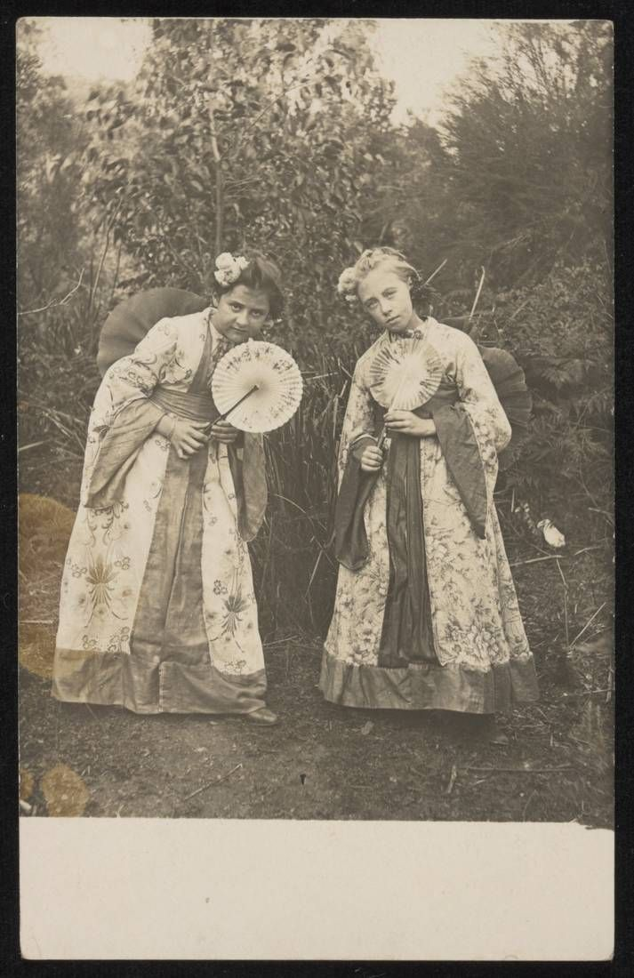 Two girls in Japanese costume, holding fans.1986