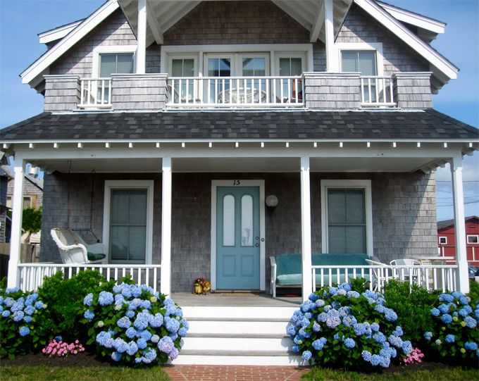 Blue hydrangeas, a gray cedar shingled house, a sweet front porch, and located in Martha's Vineyard. Drool!