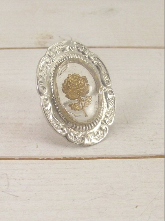 Silver vintage ring with gold rose pattern. Handmade Sterling Silver Retro Ring with a gold color rose motif. size 7.