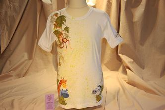 Hand painted boy's t shirt, featuring a playful jungle scene. The colors are non-toxic, water based, permanent fabric colors. This design can be fully personalized and custom made.