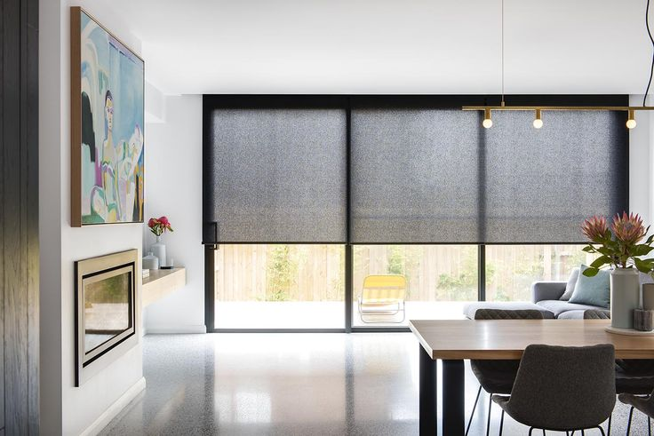 Roller blinds in Baltic translucent fabric and pumice colour. Two right panels are linked and motorised. | Window Furnishing: Roller Blinds | Room: Kitchen & Living